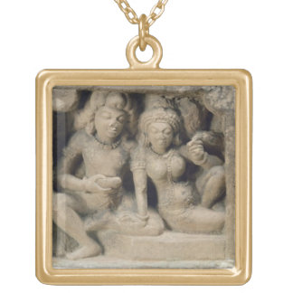 Stone carving of lovers enjoying a dance performan jewelry