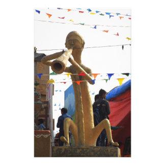 stone craft statue of street musician festivals stationery