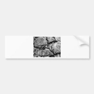 Stone faces bumper sticker