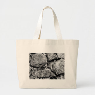Stone faces large tote bag