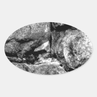 Stone faces oval sticker