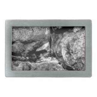 Stone faces rectangular belt buckle