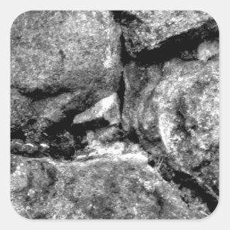 Stone faces square sticker
