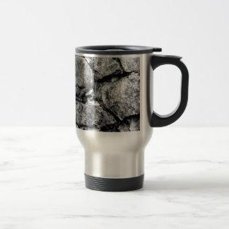 Stone faces travel mug