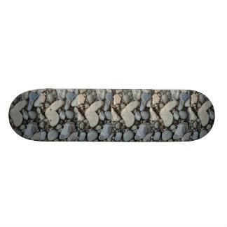 stone heart on a gravel road skateboard deck