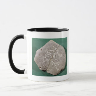 Stone inscribed with a hunter in the desert mug