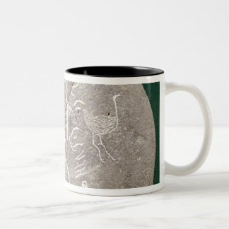Stone inscribed with a hunter in the desert Two-Tone coffee mug