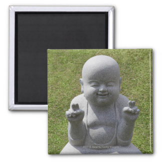 Stone statue of happy Buddha Magnet