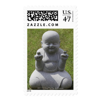 Stone statue of happy Buddha Postage