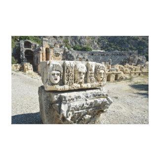 Stone theater masks in Myra Canvas Print