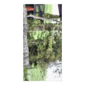 Stone wall enclosing a house photo card