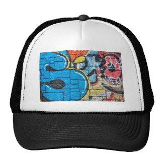 stone wall graffiti trucker hat