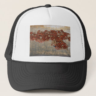 Stone wall of the old brick and plaster trucker hat