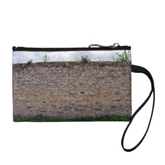 Stone Wall With Plants Against Blue Sky Change Purse