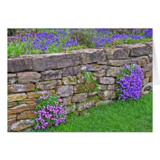 STONE WALL WITH PURPLE FLOWERS CARD