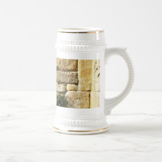 Stone Wall. With small plant. Beer Stein