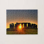 "Stonehenge at midsummer dawn. jigsaw puzzle<br><div class=""desc"">Photo jigsaw puzzle with gift box depicting the ancient 4000 year old monument of Stonehenge at midsummer dawn in the west of England.</div>"
