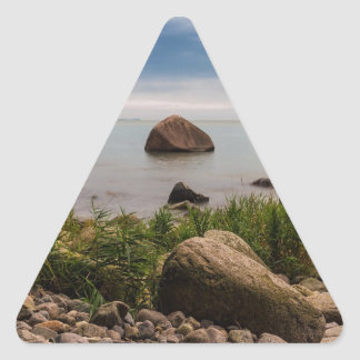 Stones on the Baltic Sea coast Triangle Sticker