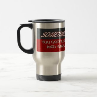 STOP AND SMELL THE RUBBER mug