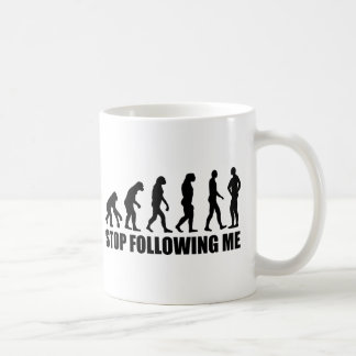Stop following me evolution coffee mugs
