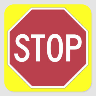 Stop sign on yellow square sticker