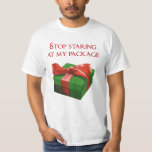 """Stop Staring at my Package Christmas Present T-Shirt<br><div class=""""desc"""">Hey,  stop staring at my package!  Don&#39;t make it so obvious that you want to unwrap my Christmas presents.  Santa could get the wrong idea.  You dirty little elf you.</div>"""