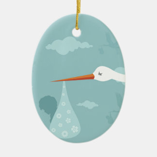 Stork and the kid ceramic ornament