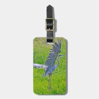 STORK BIRD ON MEADOWS. STORK ON GREEN GRASS BAG TAG