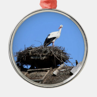 Stork on nest metal ornament