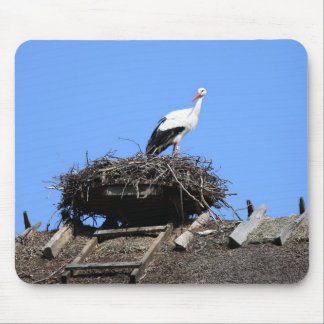 Stork on nest mouse pad