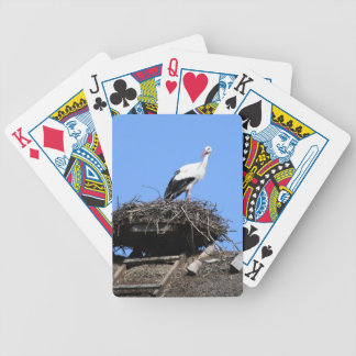 Stork on nest bicycle playing cards