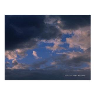 Storm clouds against blue sky postcard