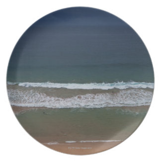 Storm clouds out ot sea above Mona Vale Beach Melamine Plate