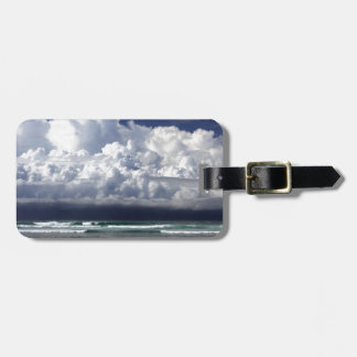Storm clouds tropical coastline tags for luggage