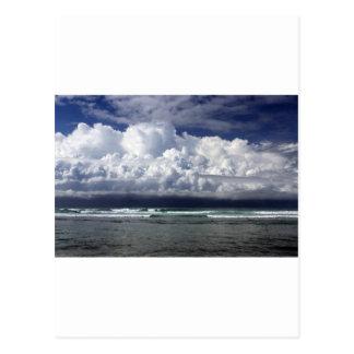 Storm clouds tropical coastline postcard