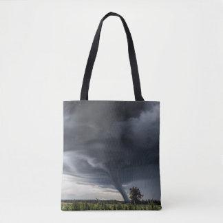 Storm tornado or twister lifing hay bales tote bag