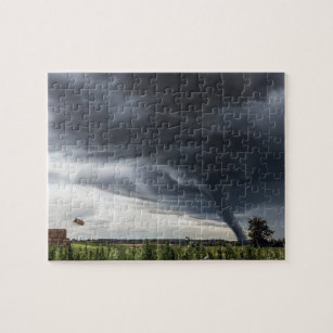 Storm tornado or twister lifing hay in bad weather jigsaw puzzle