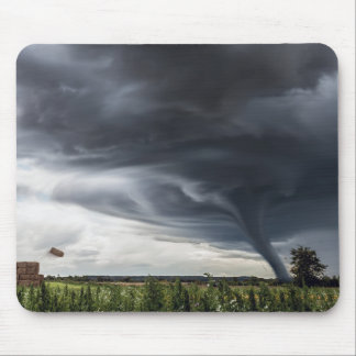 Storm tornado or twister lifing hay in bad weather mouse pad