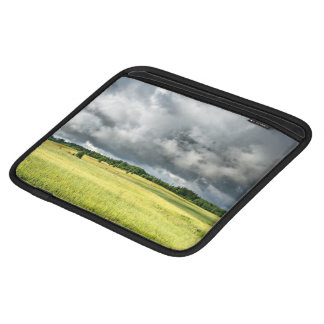 Stormy Clouds Over A Green Field Sleeve For iPads
