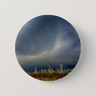stormy clouds over charlotte north carolina city s button