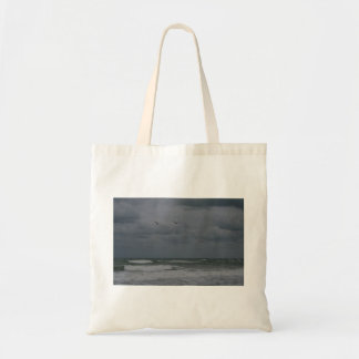 Stormy ocean with birds flying bag