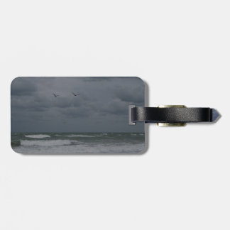 Stormy ocean with birds flying bag tag