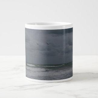 Stormy ocean with birds flying large coffee mug