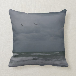 Stormy ocean with birds flying pillows