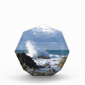 Stormy sea and sailboat along Tuscany coastline Award