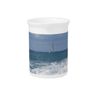 Stormy sea and sailboat along Tuscany coastline Drink Pitcher