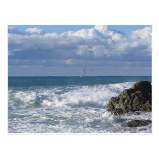Stormy sea and sailboat along Tuscany coastline Postcard
