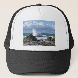Stormy sea and sailboat along Tuscany coastline Trucker Hat