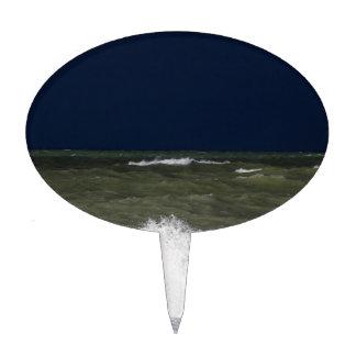 Stormy sea with waves und a dark blue sky. cake topper