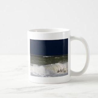 Stormy sea with waves und a dark blue sky. coffee mug
